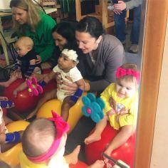 Ashlynn working hard with her buddies through conductive education